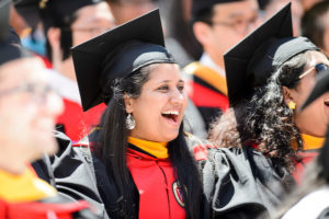 Graduates laugh during commencement speaker Steven Levitan's address during UW-Madison's spring commencement ceremony at Camp Randall Stadium at the University of Wisconsin-Madison on May 13, 2017. The outdoor graduation is expected to be attended by more than 6,000 bachelor's and master's degree candidates, and their guests. (Photo by Bryce Richter / UW-Madison)
