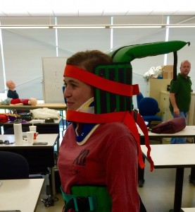 Amanda Mawrence practicing spinal immobilization for her Emergency Medical Technician course.